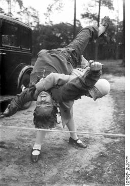 This fabulous photo dating to 1931 shows martial arts training in practical action.  Wouldn't want to be on her bad side!  It was taken in Germany; the photo is being used courtesy of the German Federal Archive and the Creative Commons Attribution Share Alike 3.0 License. (http://commons.wikimedia.org/wiki/File:Bundesarchiv_Bild_102-11989,_%C3%9Cbung_zum_Schutz_vor_%C3%9Cberf%C3%A4llen.jpg)